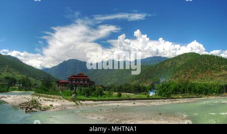 Punakha Dzong, the old capital of Bhutan, at the confluence of Pho Chu and Mo Chu rivers - Stock Photo