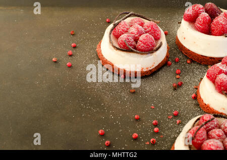 Homemade raspberry cakes on dark border background. Free space for your text. Sweet dessert made with love. - Stock Photo