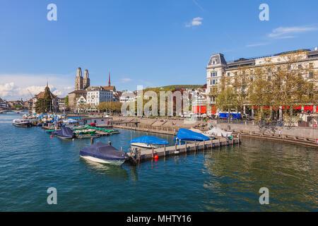 Zurich, Switzerland - 23 April, 2014: embankment of the Limmat river in the city of Zurich. Zurich is the largest city in the Switzerland and the capi - Stock Photo