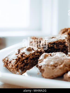 Triple Chocolate Brownies on white high key background - Stock Photo