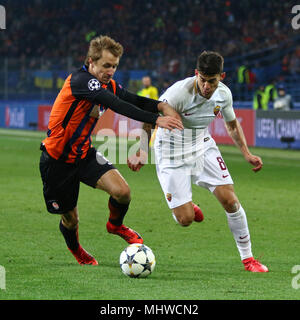 KHARKIV, UKRAINE - FEBRUARY 21, 2018: Bohdan Butko of Shakhtar Donetsk (L) fights for a ball with Diego Perotti of AS Roma during their UEFA Champions - Stock Photo