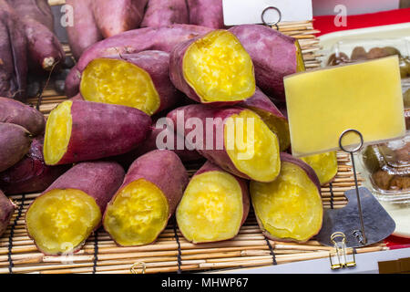 Japanese steamed sweet potato in Kuromon Ichiba market Osaka prefecture, Japan. - Stock Photo