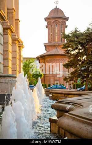 Fountains and church on background in Bucharest - Stock Photo