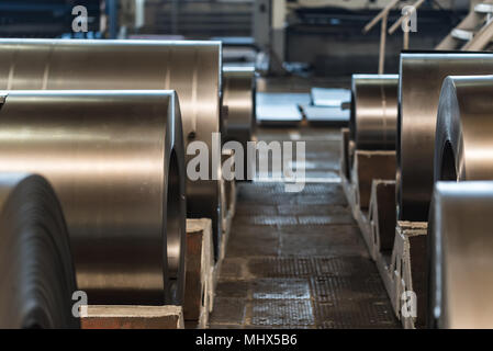 Warehouse with rolls of sheet steel in industrial plant. Hardware manufacturing - Stock Photo