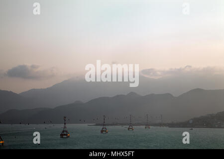 Overwater cable car transportation to an island in Nha Trang, VIetnam. Beautiful cableway and mountains seascape background with a copy space - Stock Photo