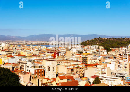 an aerial view of Cagliari, in Sardinia, Italy, with the Montelargius lake and Quartu Sant Elena in the background - Stock Photo
