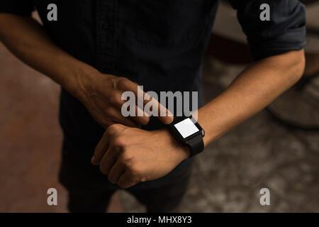 Businessman using smartwatch - Stock Photo