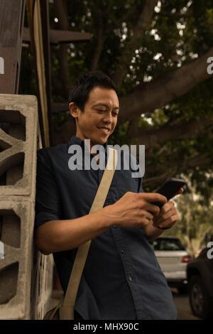 Businessman using mobile phone - Stock Photo