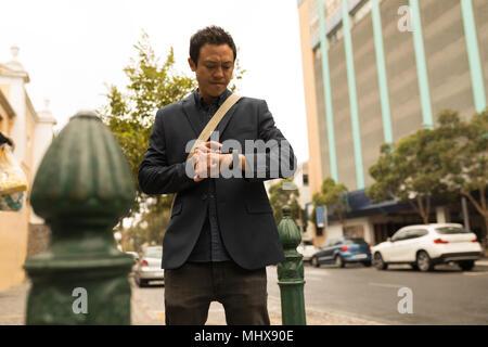 Businessman using his smartphone - Stock Photo