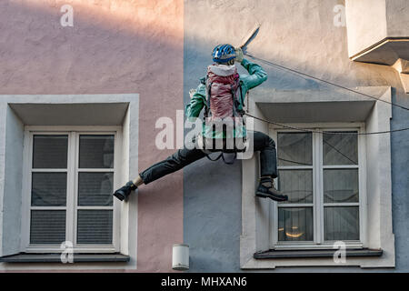 climber puppet on a building - Stock Photo