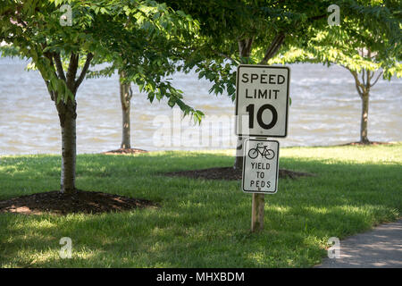 white 10 mph speed limit sign pedestrian cycling zone - Stock Photo