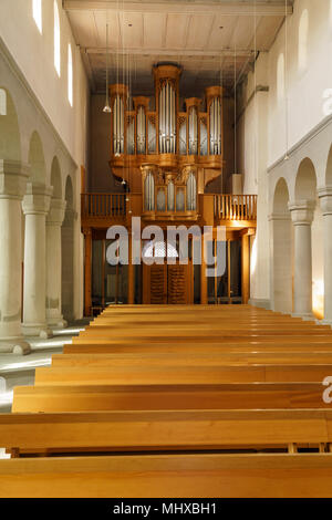 Stein am Rhein, Switzerland - October 16, 2017: The austere interior of a modern Protestant Swiss church with an organ and wooden benches - Stock Photo
