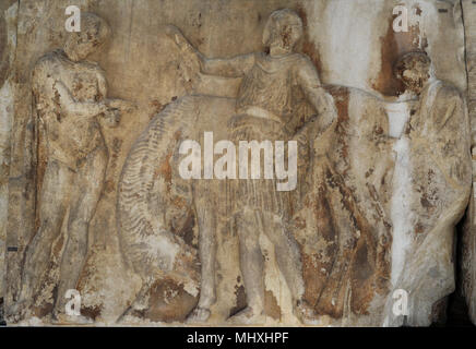 West frieze of Parthenon, Acropolis of Athens. Greece. Block W XII, figures 22-24. Preparation of the procession of the Panateneas. Herald (23), horseman (22), master's himation (24). Acropolis Museum. Athens. Greece. - Stock Photo
