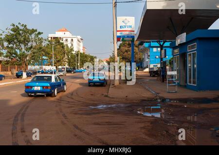 Bissau, Republic of Guinea-Bissau - January 28, 2018: View of the Amilcar Cabral Avenue (Avenida Amilcar Cabral) in the city of Bissau, Republic of Gu - Stock Photo