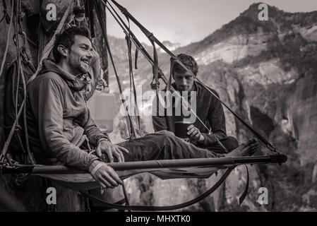 Two rock climbers on portaledge, Liming, Yunnan Province, China - Stock Photo