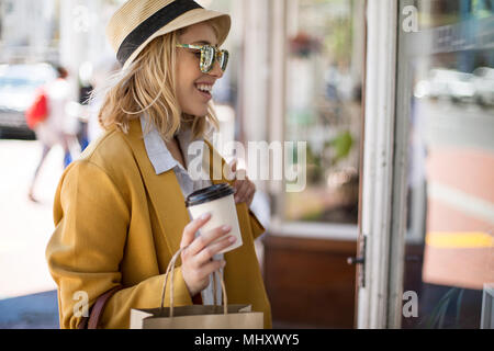 Woman window shopping, Cape Town, South Africa - Stock Photo
