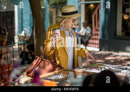 Woman at outdoor market stall, Cape Town, South Africa - Stock Photo