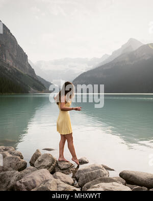Woman by Lake Louise, Canada - Stock Photo