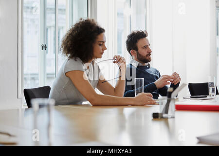 Colleagues in meeting in boardroom - Stock Photo