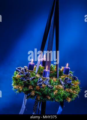 advent wreath with shiny candles, full of atmosphere - Stock Photo
