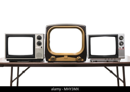 Three vintage televisions isolated on white with empty screens and clipping path. - Stock Photo