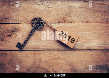 Business concept old key vintage with tag for New Year Resolution 2019. - Stock Photo