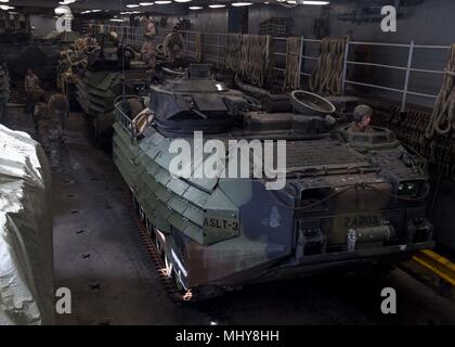 180430-N-TJ319-0251 AQABA, JORDAN (April 30, 2018) AAV-P7/A1 assault amphibious vehicles, attached to the 26th Marine Expeditionary Unit, enter the vehicle storage area aboard the Harpers Ferry-class dock landing ship USS Oak Hill (LSD 51) April 28, 2018, April 30, 2018. Oak Hill, home-ported in Virginia Beach, Virginia, is in the U.S. 5th Fleet area of operations participating in Eager Lion, a capstone training engagement that provides U.S. forces and the Jordan Armed Forces an opportunity to rehearse operation in a coalition environment and to pursue new ways to collectively address threats  - Stock Photo