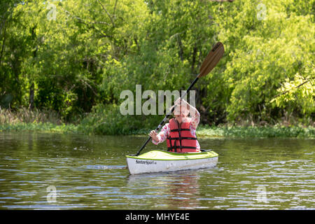 LaPlace, Louisiana - Maureen Sheahan participates in an environmental kayak tour in the Maurepas Swamp Wildlife Management Area near New Orleans. The  - Stock Photo