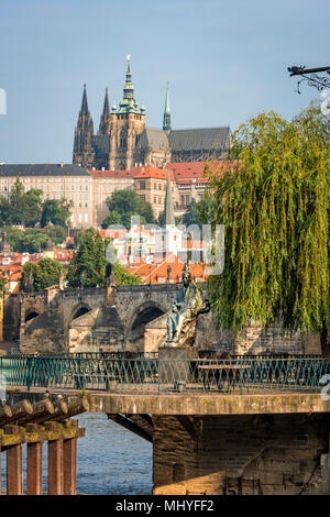 Prague, Czech Republic - May 28, 2016: Monument to composer Bedrich Smetana with St. Vitus Cathedral and Charles Bridge on background - Stock Photo