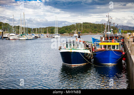 Fishing boats tied up at Tarbert, a small fishing town and ferry terminal in Argyll and Bute, Scotland, UK - Stock Photo