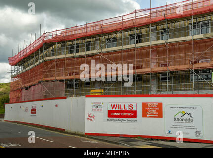 A new block of social housing apartments being built in the centre of the village of Talbot Green, Wales, on the site of the old Hand & Squirrel pub - Stock Photo