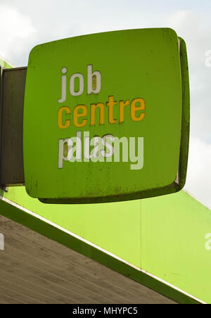 Sign on the side of a Jobcentre Plus office - Stock Photo