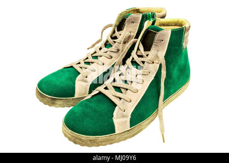 Glamorous teen green suede gumshoes isolated on white background - Stock Photo