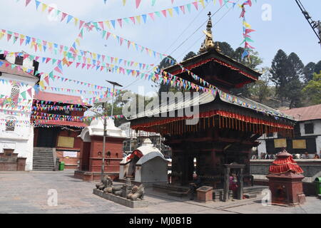 Kathmandu, Nepal - March 22, 2018: Part of the Pashupatinath temple with Kamasutra wood carvings - Stock Photo