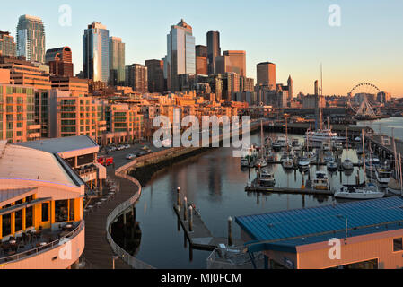 WA15322-00...WASHINGTON - Sunset over the Seattle Waterfront from Pier 66, including the Bell Harbor marina, the Great Wheel, Coleman Dock, hghrises,t - Stock Photo