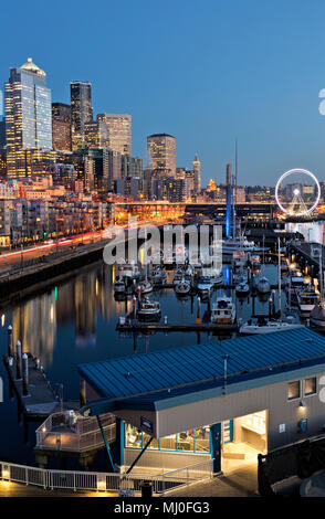WA15328-00...WASHINGTON - Night settling over the Seattle Waterfront from Pier 66, including the Bell Harbor marina, the Great Wheel, Coleman Dock, hg - Stock Photo