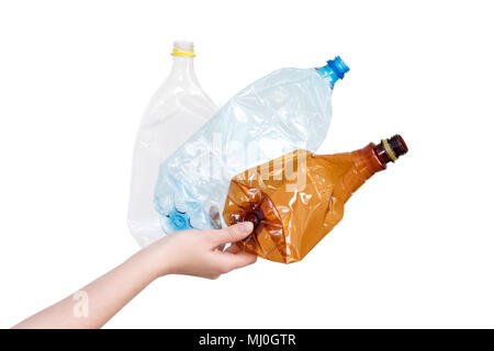 Female hand holding different types of crushed plastic bottles isolated on white. Recyclable waste. Recycling, reuse, garbage disposal, resources, environment and ecology concept
