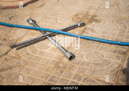 Car Repair Tools are Placed on the Ground - Stock Photo
