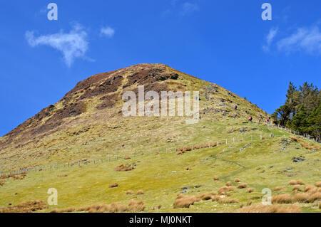 Walkers on route to summit of Mynydd Mawr near Rhyd Du, Snowdonia - Stock Photo