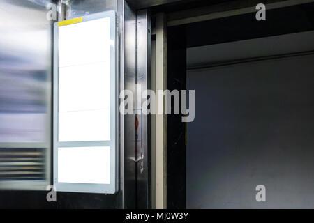 Billboard Rectangular White Mockup inside a Elevator City Advertisement - Stock Photo