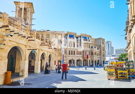 DOHA, QATAR - FEBRUARY 13, 2018: Historical buildings of Souq Waqif serve as stores, warehouses and cafes since old times, some of them preserved such - Stock Photo