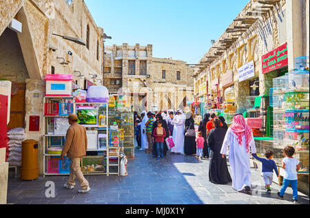 DOHA, QATAR - FEBRUARY 13, 2018: The Pet Market, of Souq Waqif with crowd of locals, looking for interesting birds or pets for children, on February 1 - Stock Photo