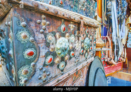 The close-up of vintage wooden trunk, decorated with carved metal details and rivets, inlaid with gemstones, Souq Waqif, Doha, Qatar. - Stock Photo