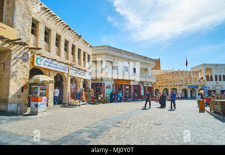 DOHA, QATAR - FEBRUARY 13, 2018: The neighborhood of old market -  Souq Waqif is full of historical buildings, authentic mansions, caravanserai inns,  - Stock Photo