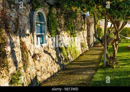 Early morning in a garden courtyard of a Mediterranean villa along the Amalfi Coast in Praiano, Campania, Italy - Stock Photo