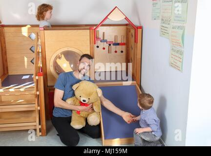 A Male Educator teacher in Kindergatrten - Stock Photo