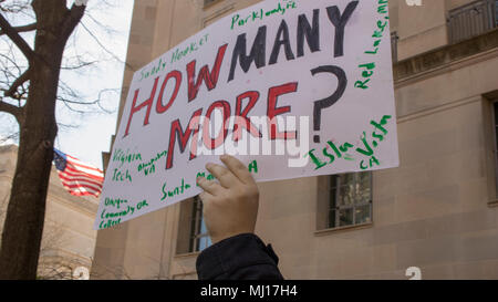 WASHINGTON, DC. – MARCH 24 2018: A protester holds a sign reading 'How many more' at the March for Our Lives protest in Washington DC - Stock Photo