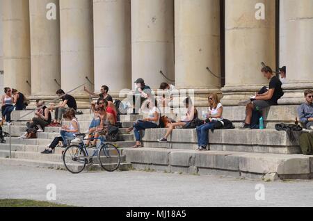 The Glyptothek in Munich, built by Leo von Klenze: people enjoying the sun - Stock Photo