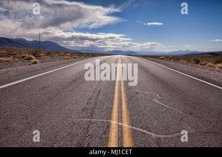 Road through desert area near Death Valley, California. - Stock Photo