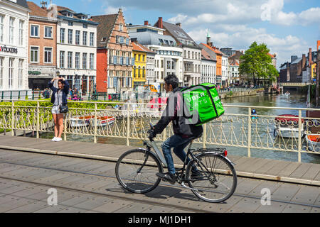 UberEATS / Uber Eats online meal ordering and delivery platform, bicycle courier delivering meals in the city center of Ghent, Belgium - Stock Photo